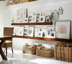 ledge shelves to display portraits, pictures, and art --- Love this for a gallery wall