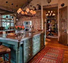 Southwest colors and accents...love the island and wood door and cabinets