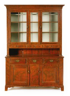 A VERY FINE FEDERAL RED AND BLACK PAINT-DECORATED POPLAR STEP-BACK CUPBOARD, PENNSYLVANIA, CIRCA 1800