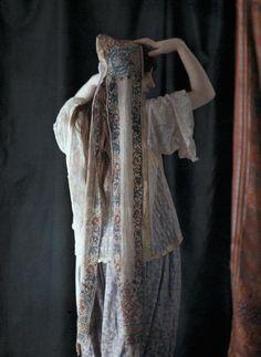 An Algerian woman models a headdress worn only on festive occasions, Algeria (1928)