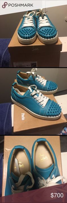 Women's Louboutin sneaker size 35 1/2 (35.5) Women's Louboutin spike sneaker. No wear and tear on leather. White trim just needs a wipe down. Comes with box and dust bag Christian Louboutin Shoes Sneakers
