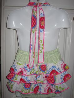 Back view--LOVE the floral print on the ruffles.  Ruffle butt sunsuit.