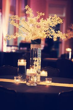 These centerpieces are beautiful and elegant! Photo by Jeannine. #MinneapolisWeddingFlorists #WeddingFlorals