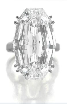 Exceptional and rare Diamond ring, Harry Winston Set with a modified oval step-cut diamond weighing 36.43 carats