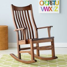 Nursery Rocker Chair: Classic Wooden Rocking Chair - Classic Wooden RockerFloor to seat:  17Seat depth: 18 by The Land of Nod $499