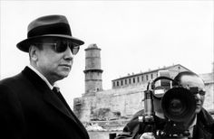 """Jean-Pierre Melville on the set of """"Le Samourai"""" in Marseille"""