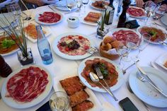 A full table in Costa Brava Spain with meat and cheese and plenty of wine!