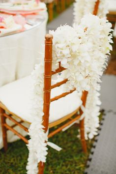 This is how you dress up a wedding chair: http://www.stylemepretty.com/destination-weddings/2014/11/17/intimate-kauai-wedding/ | Photography: Sea Light Studios - http://sealightstudios.com/