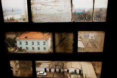Carolyn Drake, Khujand viewed through a window in the Leninabad Hotel. The city was established by Alexander the Great 2,500 years ago on the banks of the Syr Darya (framed in the upper left corner). Tajikistsan, 2009