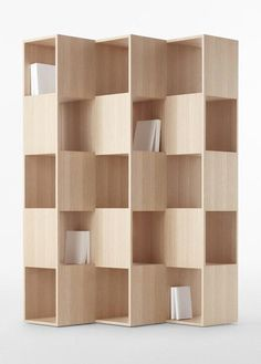 Fold is a minimalist design created by Tokyo-based design firm, Nendo. The shelving unit is composed of interlocking wooden boards that are oriented in different positions. The Japanese manufacturer Conde House is responsible for its manufacture. Modern Bookshelf, Bookcase Shelves, Bookcases, Shelving Units, Timber Shelves, Unique Bookshelves, Corner Shelves, Plywood Bookcase, Office Shelving