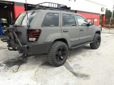 Tire swing arm includes single gas can carrier and high lift jack mount. 2008 Jeep Grand Cherokee, Jeep Cherokee, Jeep Liberty Lifted, Jeep Grand Cherokee Accessories, Jeep Patriot Sport, Jeep Wk, Jeep Bumpers, Overland Truck, Bed Liner