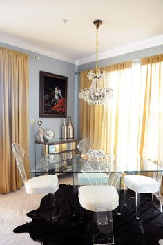 Cowhide, grey walls with gold drapery, clear furniture