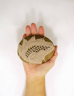 Irish Crochet Lace Collectible Heirloom Lace Rustic Beach Stone Paperweight  Natural Stone Decor Country Rustic Cottage Crochet Lace Stone. $40.00, via Etsy.