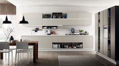 Tall wall units ane recessed grips give the Foodshelf a stunning look - Decoist