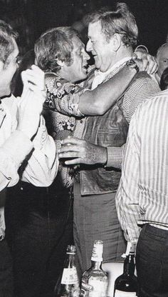 Steve McQueen and John Wayne. LOVE this photo! Looks as we say in Aus a bit tired and emotional.
