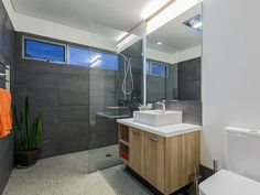 Charcoal Tiles, Timber Veneer Vanity, Bathroom Design, polished concrete flooring, highlight windows