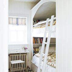 Stacked twin beds get a character boost from an arched enclosure.   Photo: Polly Wreford/Loupe Images   thisoldhouse.com