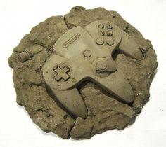 Modern Fossils an ingenious sculpture series by artist Christopher Locke. High School Art, Middle School Art, Nintendo 64, Consoles, Deco Gamer, Concrete Art, Archaeology, Art Lessons, Art Pieces