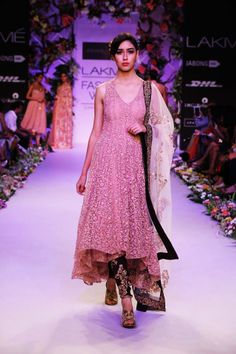 A gorgeous peach colored dress displayed at the Lakme Fashion Week 2014.  Source: indianweddingsite.com