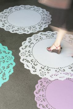 Set of four doilies for the floor, $55.00. Could be useful in a store or window display...