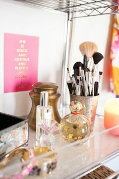 Pretty makeup brush and perfume vanity shelf