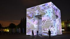 Marcos Zotes, 2015 Polytechnic Museum. Moscow, Russia  P-Cube is a project by architect and artist Marcos Zotes (ES / IS) with music by Pixelord (RU). Commissioned by the Polytechnic Museum in Moscow, Russia during May 2015.  P-Cube consists of a 9 meters high, 9 meters wide scaffolding structure. Its surfaces are wrapped with a semi-transparent layer of fabric, providing a ghostly and ephemeral appearance during the daytime and becoming fully alive with light and projections during the...