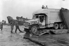 D-Day, June 1944 June 1944. Normandy, France. The Daniel Boone was the first American Red Cross clubmobile to land in Normandy, France, following D-Day and saw action all the way through Austria. This scene shows the clubmobile landing with invasion troops on the Normandy Beach.