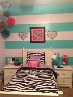 Zebra print purple pink teal gray big girl tween bedroom with stripes behind bed