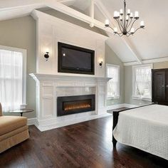 Electric Fireplace Insert. I'd fall over dead if I ever was able to put a fireplace in my bedroom.