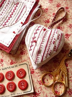 Embroidered pin cushion Love the color texture combo. this gals blog has lots of stitch work