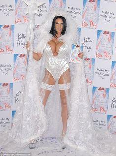 Bibbidi-Bobbidi-Boobs! Katie Price displays her ample cleavage in the fairy godmother of a...