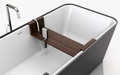 Modern Bathtub with Customizable Accessories and Attachments – Bathe - The Great Inspiration for Your Building Design - Home, Building, Furniture and Interior Design Ideas Bathroom Accesories, Bath Accessories, Sky Design, House Design, Bathtub Shelf, Modern Bathtub, Rental Bathroom, Yanko Design, Corian