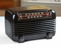 This is a handsome, fully functional, 1948 Philco Transitone, Model 48-250, table top AM tube radio with a beautiful Bakelite body with light-up dial.