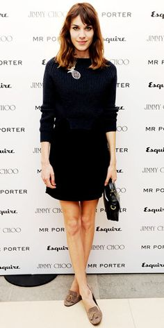 Alexa Chung in a cropped knit top, black pencil skirt, leather tote and  suede 7883a0036c
