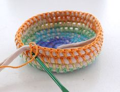 Crochet basket - yarn over cord, twine, t-shirt yarn or other thick material.
