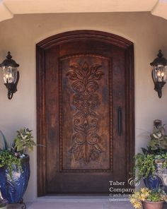 taberandcompany.com  Doors Spanish Mediterranean Style Hacienda includes a statement in hand carving with a heart of flowers.