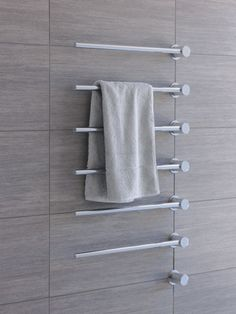 Heated towel rails are now becoming a common addition to bathrooms. It's interesting to see how the invention of central heat has not only transformed the layout of buildings and how we use spaces, but also the bathrooms. Fire was once the only source of heat in the home and now we have a heat source designed just for towels.