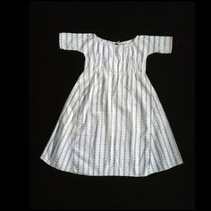 "Child's dress, printed cotton 1785-1810 Origin: England (textile); England or America (dress) OL: 26""; Width at skirt widest part 26"" Block-printed cotton. Colonial Williamsburg Acc. No. 1992-139"