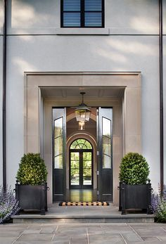 Lovely cast stone trimmed front entry with glass doors on stucco facade