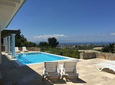 Entire home/apt in Soğucak, TR. Luxurious villa, overlooking the Aegean Sea and Samos, with its own private pool.  The villa is situated in a beautiful kept green estate (gated community) only minutes away from the beach and nearby Kusadasi.