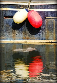 Buoy reflections in the calm, sheltered waters of Hall's Harbour