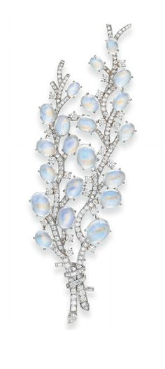 A MOONSTONE AND DIAMOND 'PUSSY WILLOW' SPRAY BROOCH, BY TIFFANY & CO. Designed as two single and circular-cut diamond stalks set with oval cabochon moonstone blossoms, gathered by a baguette-cut diamond ribbon, mounted in platinum, in a Tiffany & Co. black suede case Signed Tiffany & Co., no. 17650802 20th century