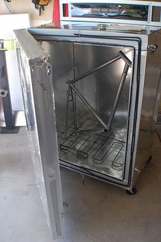 Homemade powder coating oven adapted from a surplus double-wall kitchen oven.