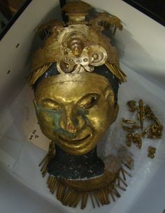 Pre-Columbian tumbaga gold mask, headdress, breast plate, ear decorations, etc. known as the El Canto treasure found circa 1936 in Colombia and now owned by Dr. E. Lee Spence who acquired it from the grandson of the discoverer. The green is from the copper that was alloyed with the gold. Photo by Dr. E. Lee Spence