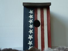From my shop for Independence Day!  Americana Cedar Bird House with stars and stripes. $33.00, via Etsy.
