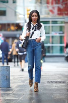 """""""I've always been a fan of high-waisted anything—and with a 10-inch rise, these 3x1 jeans are my current go-to. A pussy-bow blouse and leopard booties balance out the casual vibe of the boot cut."""" -Chrissy Rutherford, BAZAAR.com Senior Digital Editor"""
