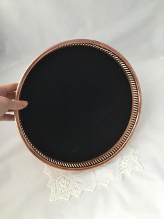 A personal favorite from my Etsy shop https://www.etsy.com/ca/listing/254175954/vintage-copper-tray-round-copper-and