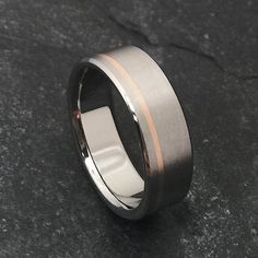 Ring is shown with an 18k solid rose gold inlay, matte finish with polished edges, and a 7mm width. ➣Each ring is hand carved from a single solid piece of 6al-4v aircraft grade titanium. ➣Please note the following additional options in the Note to ClassicTitanium section during checkout. ★FINISH- polish, satin, matte, or as shown ★GOLD COLOR- 18k Rose Gold, 18k Yellow Gold, or 18k White Gold ★INSIDE ENGRAVING- Free of charge up to 40 characters Font choices include Goudy (default), Scrip...