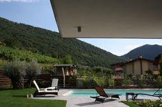 Giardino con piscina - arredo giardino - villa a Paratico