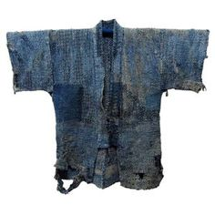 """Antique Japanese Cotton Fisherman's Jacket Japanese Fisherman's Winter Jacket. Sashiko no Donza Indigo Cotton. Home Spun & Hand Loomed. Detailed Sashiko, boro patched, then patched again. Age Early 1900s From Nigata Prefecture """"Sea of Japan""""."""